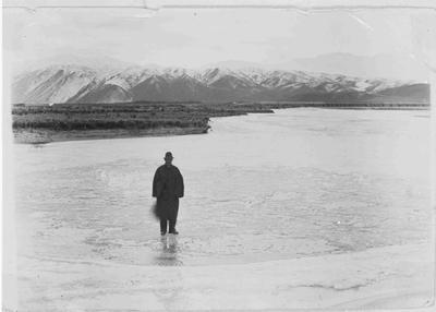 Local Policeman standing on frozen Waitaki River