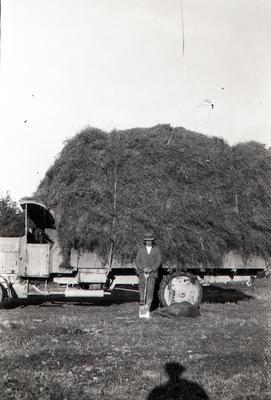Kurow Motor Garage truck moving hay