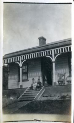 Four children on house steps