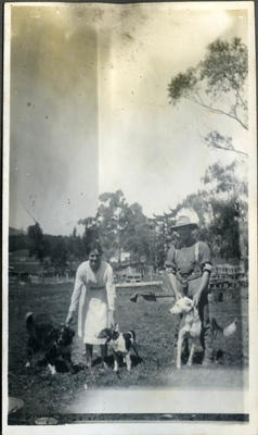 Man and woman with dogs