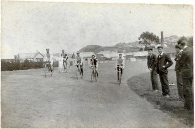 Five men on cycles ( with Cape Wanbrow in the background)