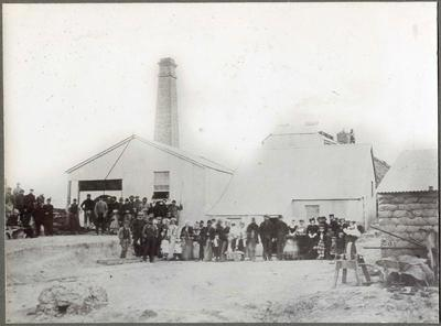 A large group of people outside a flour mill.