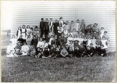 Kinderspiel. A large group of children outside the Old Town Hall in Palmerston