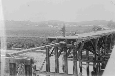 First Kakanui Bridge (built 1872) in process of demolition, c. 1899. Second bridge opened in 1899; 2840P