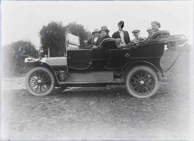 Unidentified group in motor car