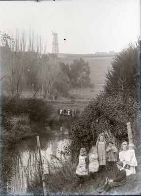 Children at Oamaru Public Gardens. Hassell's Windmill