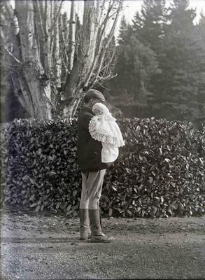 Unidentified man with baby. Elderslie Estate
