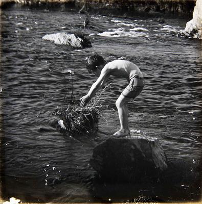 Boy at river. Unidentified