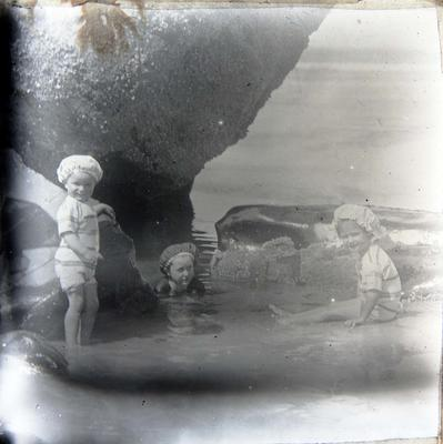 Children at the beach. Unidentified