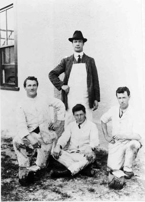 Thomas Nightingale, Painter, (standing) and his staff.
