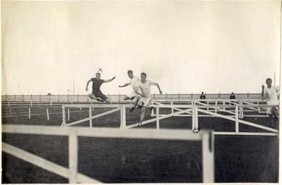 Elliot breaking the 120 yards hurdles. Waitaki Boys' High School; P0109.063.14