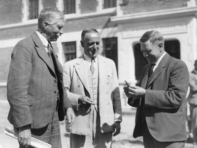 Frank Milner, Rector of Waitaki Boys High School with two Canterbury College men