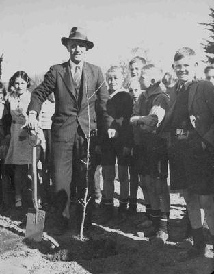 J C Kirkness planting tree celebrating the New Zealand Centennial 1840 - 1940.