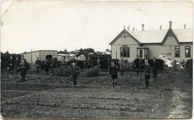 Schoolboys working in a garden at Weston School.