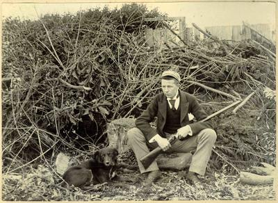 Unidentified man,  with dog