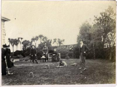Men and women playing croquet; 2014/45.02.036