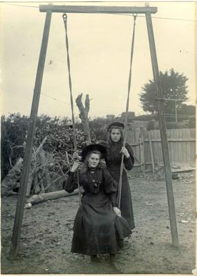 Two girls with a swing; 2014/45.02.044