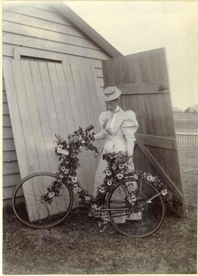 Woman with decorated bicycle