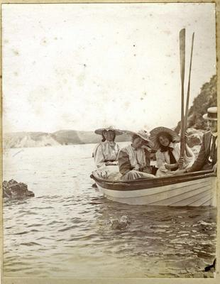 Women and man in a dinghy