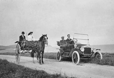 Horse & buggy and car beach road