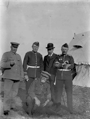 Unidentified men. Military camp