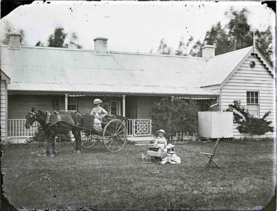 Family group in front of private dwelling
