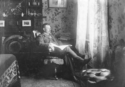 J M Forrester in Living room