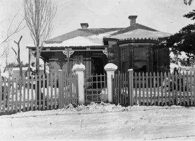 House in snow, possibly Bond family