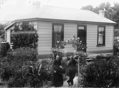 Unidentified couple in front of family home