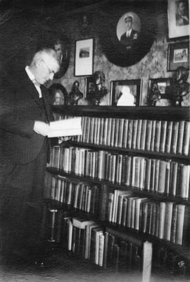 George Meek (?) in his library