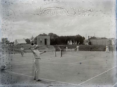 Unidentified men and women playing tennis