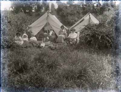 Men and women camping