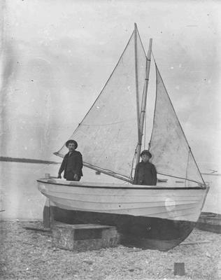 Man and boy in boat unidentified. Oamaru Harbour
