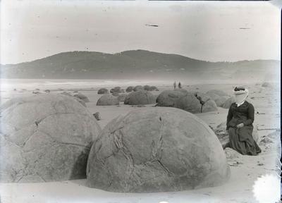 Moeraki Boulders.  Unidentified woman