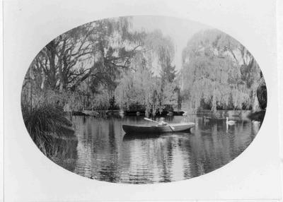 Elderslie Estate lake with boat and swans