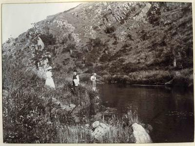 Unidentified people at a river
