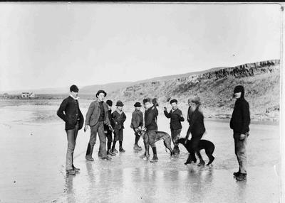 Unidentified group on Ice.  Frozen duck pond over the bank from Kurow Township, Anglican Church in background. Probably the big freeze of 1885 - 1895