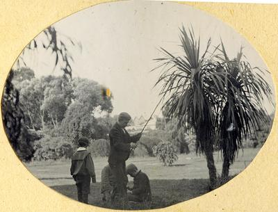 Unidentified man and boys; 2014/45.01.047
