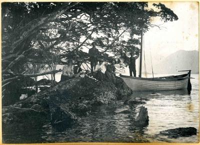 Men and women at a lake