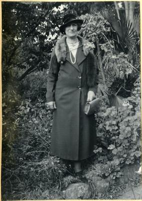 Woman standing in a garden; 2014/45.01.114