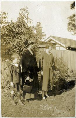 Women and boy in a garden