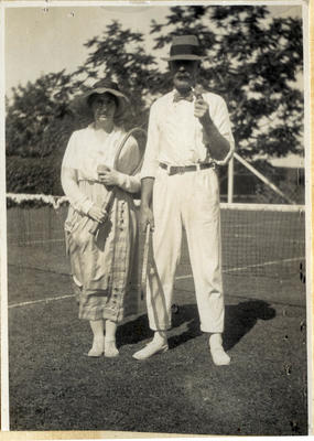 Man and woman on a tennis court; 2014/45.01.161