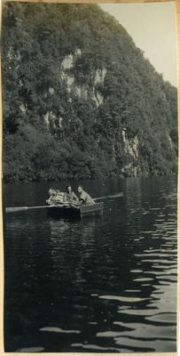 Two men in row boat