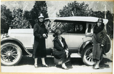 Three women with a car