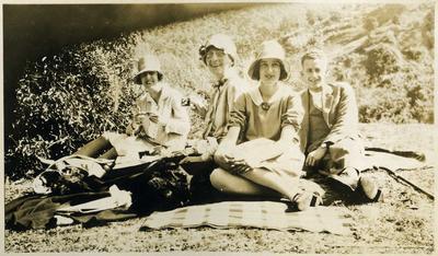 Women and man picnicking