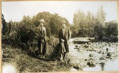 Two women beside a creek