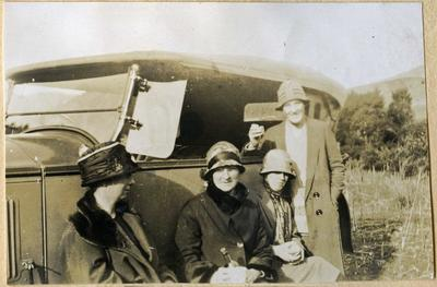 Four women with a car; 2014/45.01.228