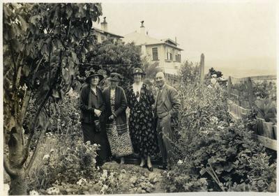 Women and man in a garden