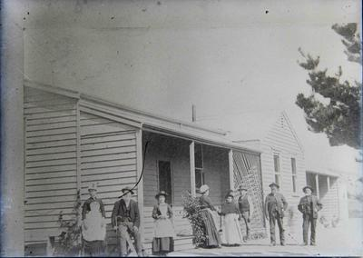 Unidentified people in front of house