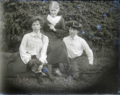 Three women and dog